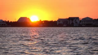 Sun sets ocean side town houses 4k
