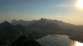 Sun setting over Rio de Janeiro seen from Mountain top 4k