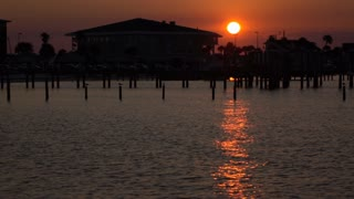 Sunset at dock with city in background slow motion