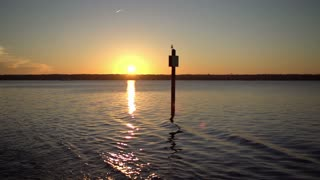 Sunset on water in slow motion