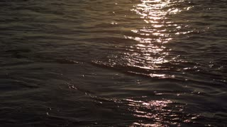 Sunset reflection in water slow motion