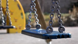 Swing at playground with no kids playing 4k