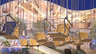 Swing seats hanging with no riders at carnival 4k