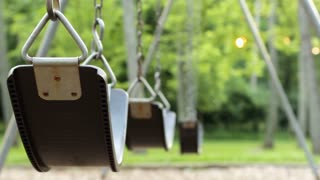 Swings in playground with no children