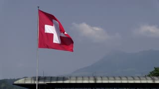 Swiss flag with birds flying by