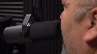 Talk show radio host in studio talking into microphone 4k
