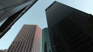 Tall buildings in downtown of city tilt shot