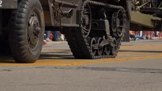 Tank continuous track going across concrete street 4k