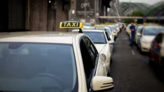 Taxi cabs lined up at station
