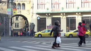 Taxi station in Prague with pedestrians.