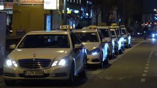 Taxi stop with lined up vehicles waiting for customers in Frankfurt Germany 4k