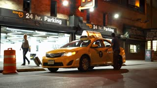 Taxi stopped in front of parking garage in New York City 4k