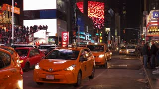 Taxi vehicles in downtown Times Square at stop light 4k