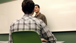 Teacher in front of class talking