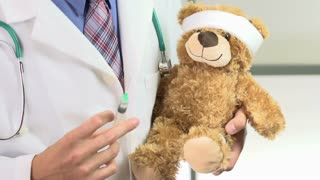Teddy bear injected with needle