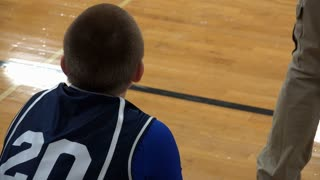 Teen basketball player put into game from bench 4k