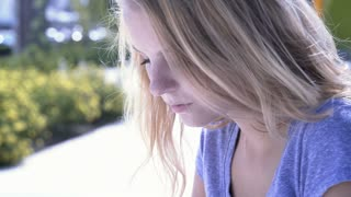 Teen girl texting on phone outdoors 4k
