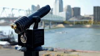 Telescope across from city