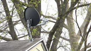 Television satellite dish on roof of home 4k