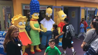 The Simpsons posing with family