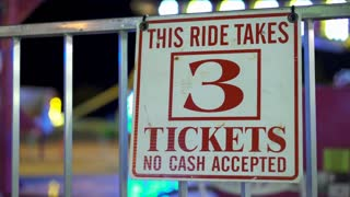 This ride takes 3 tickets sign at carnival 4k