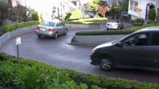 Three Cars going down Lombard Street