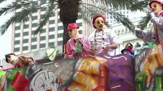 Throwing beads from Mardi Gras float slow motion