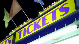 Tickets sign displayed at carnival during night time 4k