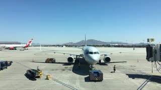 Time Lapse of airplane taxied back from terminal gate at Las Vegas Airport 4k