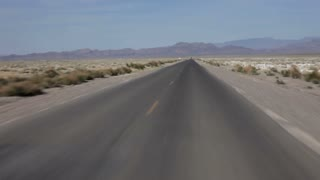 Time lapse of driving down desert road POV
