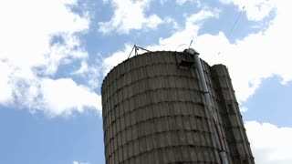Time Lapse of Farm Silo with Clouds