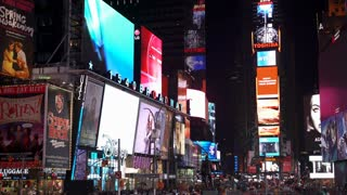 Times Square lit up at night in New York City 4k