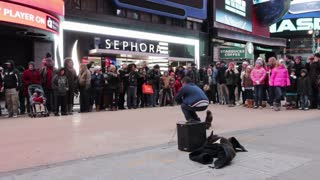 Times square street performer with crowd