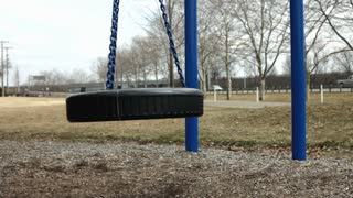Tire swing swaying in park