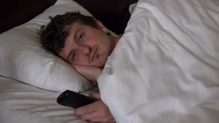 Tired man turns off tv and goes to sleep 4k