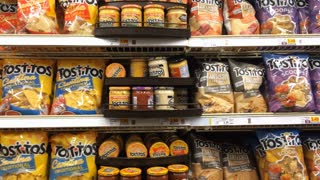Tostitos chips in grocery store aisle
