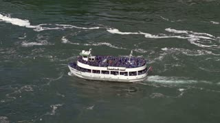 Tour boat at Niagara Falls in slow motion