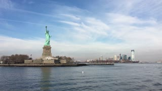 Tour Boat circling Liberty Island with New Jersey in background 4k
