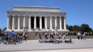 Tourists at Lincoln Memorial sitting on steps 4k