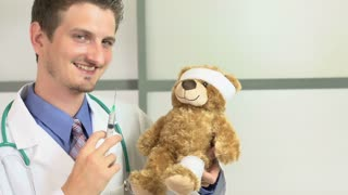 Toy bear receives shot from doctor