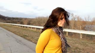 Tracking shot of Girl walking down road