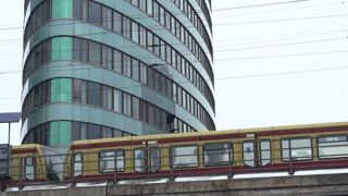 Tracking train going by office building slow motion