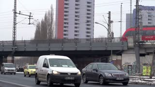 Traffic and train going by in Berlin slow motion