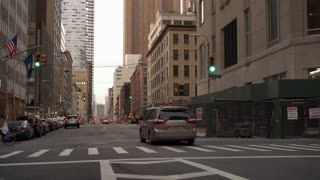 Traffic going down city streets in downtown New York 4k
