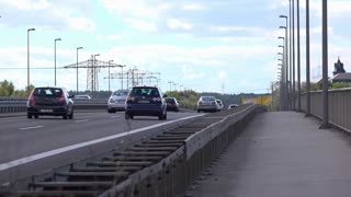 Traffic going down German highway on cloudy day 4k