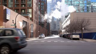 Traffic going down N Illinois avenue downtown Chicago 4k