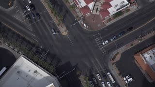 Traffic going through intersection aerial view 4k