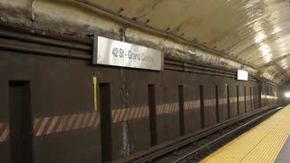 Train enters 42 Street and Grand Central subway station in New York 4k