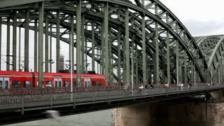 Train going by on popular lock bridge in cologne germany