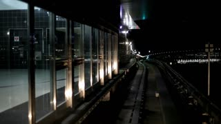 Train pulling out of station at night